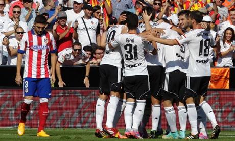 Valencia players celebrate as they beat the La Liga champions.