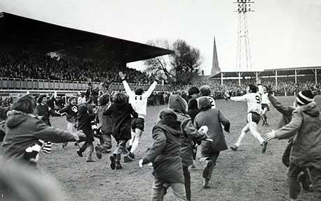 Radford wheels away to be mobbed by fans after his goal
