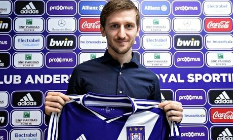 Marin holding up the Anderlecht shirt that he hopes to be wearing as he seeks to resurrect his career in Belgium.