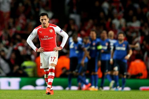Alexis Sanchez trudges off after the Gunners just fall short of overturning the first leg deficit.
