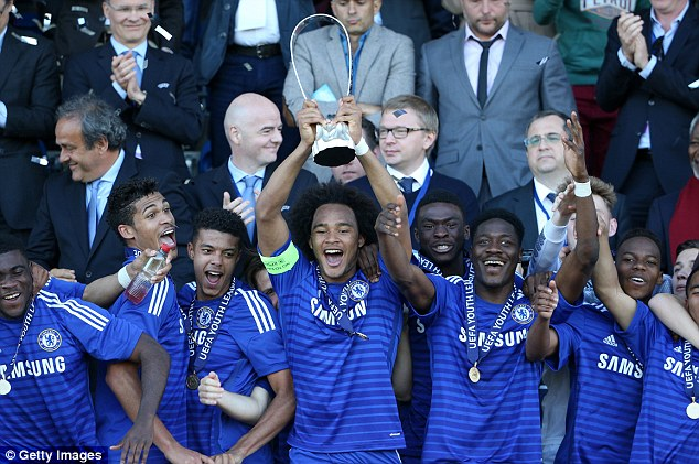 Captain Izzy Brown lifts the trophy that made Chelsea's youngsters the U19 Champions of Europe