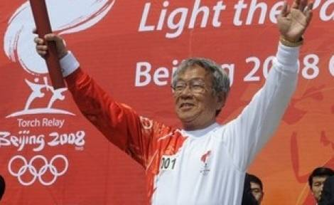 Pak Doo-Ik with the Olympic Torch.