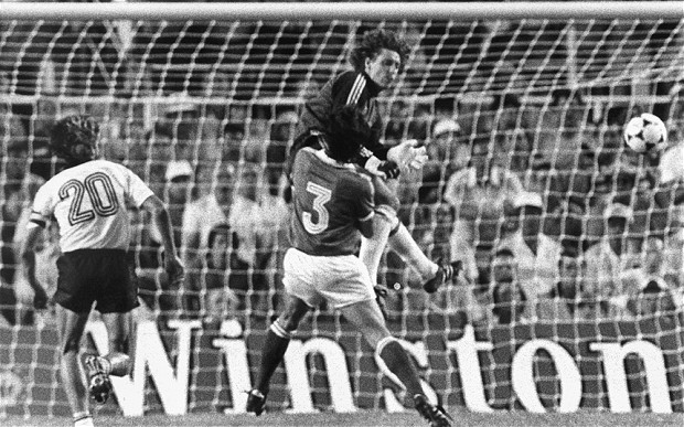 west german goalkeeper Harald 'Toni' Schumacher crashes into French player Patrick Batrtiston.