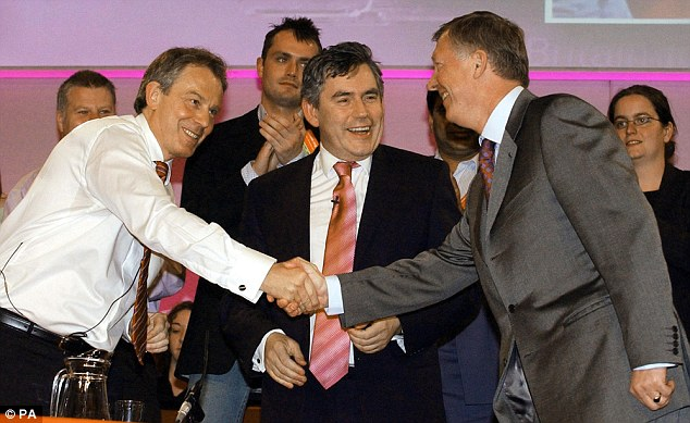 Tony Blair glad hands Sir Alex Ferguson as Gordon Brown watches on.