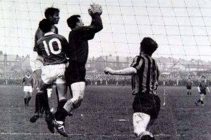Wallace catches a cross in the game that defined the term 'shock reult' in Scottish folotball history.